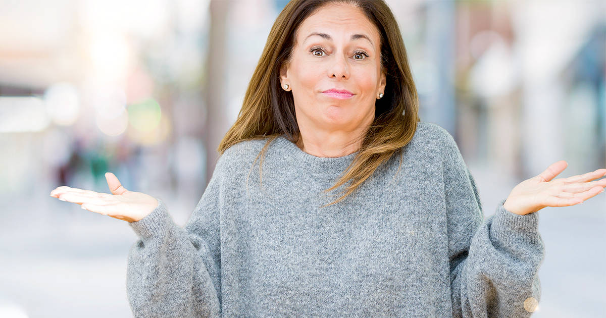 shrugging woman can you be a life coach when life isn't perfect
